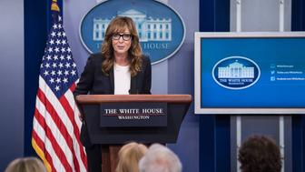 US actress Allison Janney, who played the role of press secretary C.J. Cregg on the television drama The West Wing, arrives at the podium in the White House briefing room as she makes a surprise appearance to highlight a White House initiative to prevent prescription drug abuse and heroin use, increasing access to treatment, and supporting the millions of Americans in recovery, in Washington, DC, on April 29, 2016. / AFP / NICHOLAS KAMM        (Photo credit should read NICHOLAS KAMM/AFP/Getty Images)