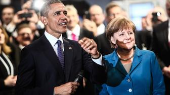 HANOVER, April 25, 2016-- German Chancellor Angela Merkel, right front, and U.S. President Barack Obama visit Rittal's stand during their tour at the 2016 Hanover Industrial Trade Fair in Hanover, Germany, on April 25, 2016. More than 5,200 exhibitors from over 70 countries and regions attended the fair. (Xinhua/Zhang Fan via Getty Images)