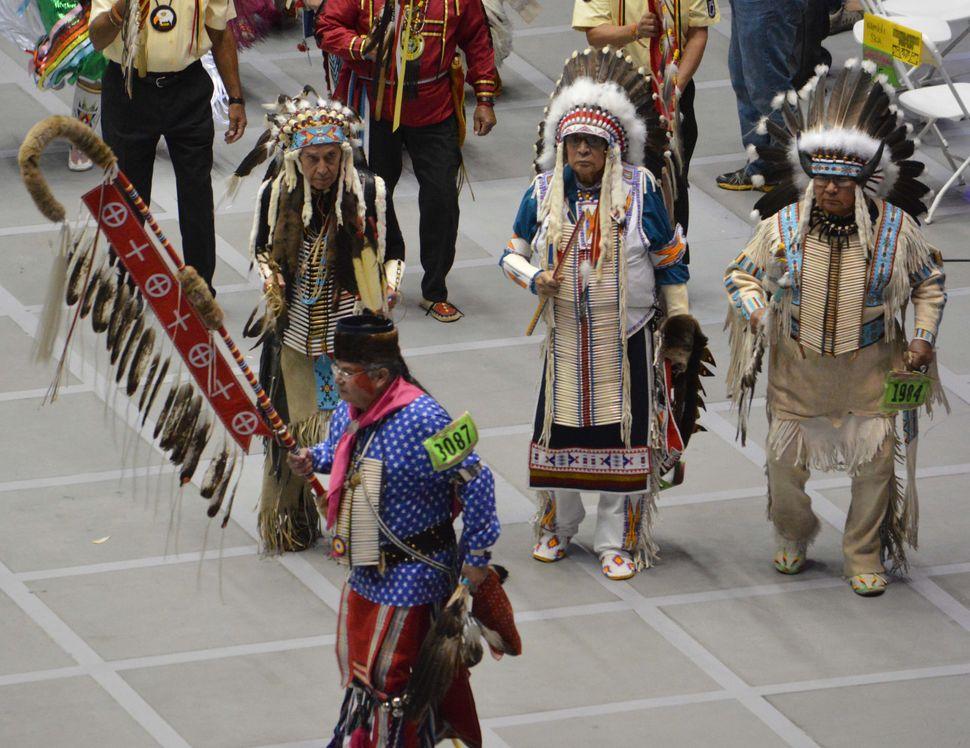 Elders leading the Grand Entry