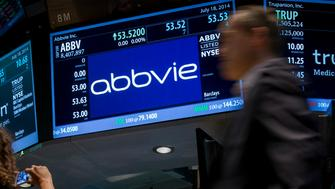 A screen displays the share price for pharmaceutical maker AbbVie on the floor of the New York Stock Exchange July 18, 2014. Shire said on July 18 that it had accepted an offer of 32 billion pounds ($54.7 billion) from AbbVie. The U.S. pharmaceutical company will pay 24.44 pounds in cash and 0.8960 of a new AbbVie share for each Shire share. REUTERS/Brendan McDermid (UNITED STATES - Tags: BUSINESS)