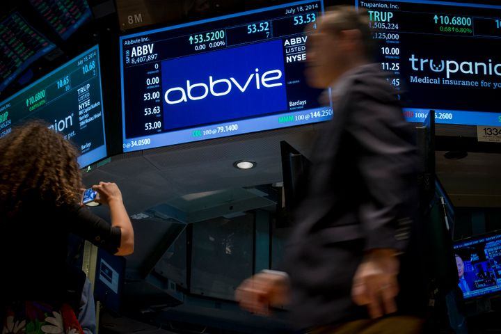 A screen displays the share price for pharmaceutical maker AbbVie on the floor of the New York Stock Exchange July 18, 2014.