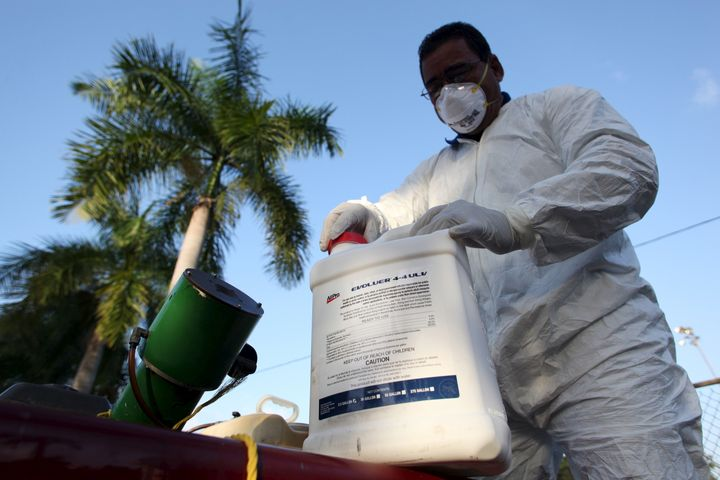 A health worker prepares insecticide before fumigating in a neighborhood in San Juan in January.