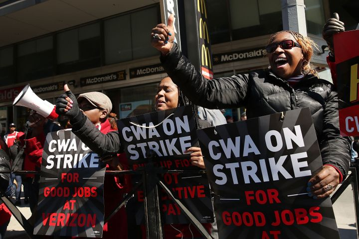 Hundreds of Verizon workers strike outside of the telecommunications company's Brooklyn offices on April 13 in New York City.