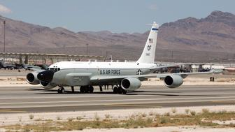 NELLIS AFB, NV - APRIL 25:  A United States Air Force RC-135 RIVET JOINT aircraft takes off from Nellis Air Force Base while participating in the Joint Expeditionary Force Experiment 2006 (JEFX 06) April 25, 2006 in Las Vegas, Nevada. JEFX is a biannual test of new systems and technologies by every branch of the military in an attempt to speed their introduction into the modern battlefield. This year's tests involve about 1,400 personnel from the United States, Great Britain, Canada and Australia studying new technologies during mock combat over the Nevada desert and center on finding better ways to communicate critical information between armed forces.  (Photo by Ethan Miller/Getty Images)