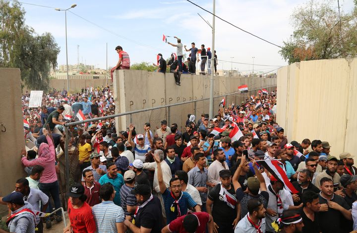 Sadr supporters enter the highly-fortified Green Zone in Baghdad on Saturday. A United Nations spokesman and four Wester