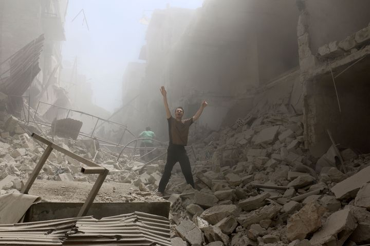 A man stands amid the rubble of an airstrike on Aleppo on Thursday. The escalating violence has all but destroyed the ceasefi