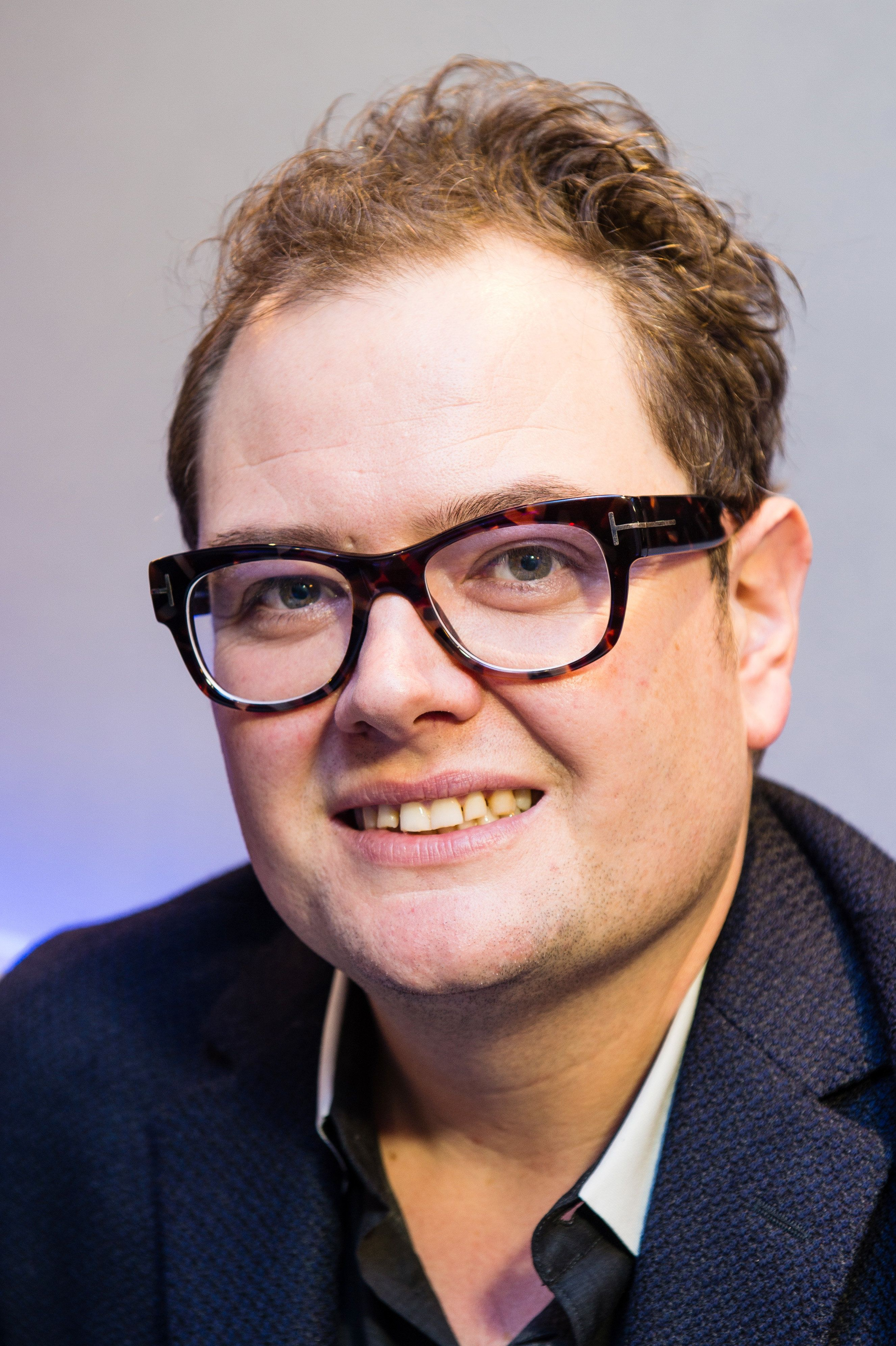 Alan Carr reveals some of the worst slurs on his personality have come from within the gay