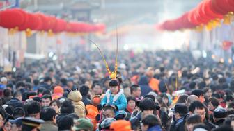 A girl wears a monkey king headwear at a festival fair during Chinese Lunar New Year celebrations in Qingdao, Shandong Province, China, February 16, 2016. REUTERS/China Daily ATTENTION EDITORS - THIS PICTURE WAS PROVIDED BY A THIRD PARTY. THIS PICTURE IS DISTRIBUTED EXACTLY AS RECEIVED BY REUTERS, AS A SERVICE TO CLIENTS. CHINA OUT. NO COMMERCIAL OR EDITORIAL SALES IN CHINA.      TPX IMAGES OF THE DAY