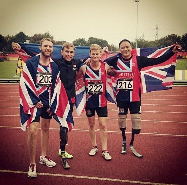 Marine Sam Stocks, second right, will celebrates his race at the first ever Invictus Games in London,...