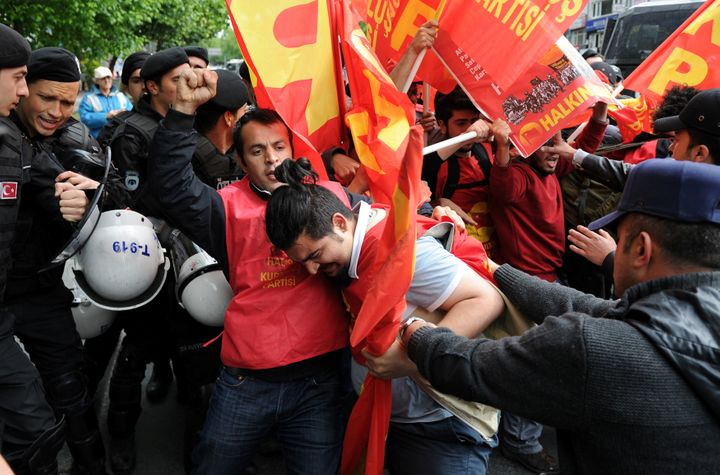 Turkish riot police scuffle with a group of protesters as they attempted to defy a ban and march on Taksim Square.