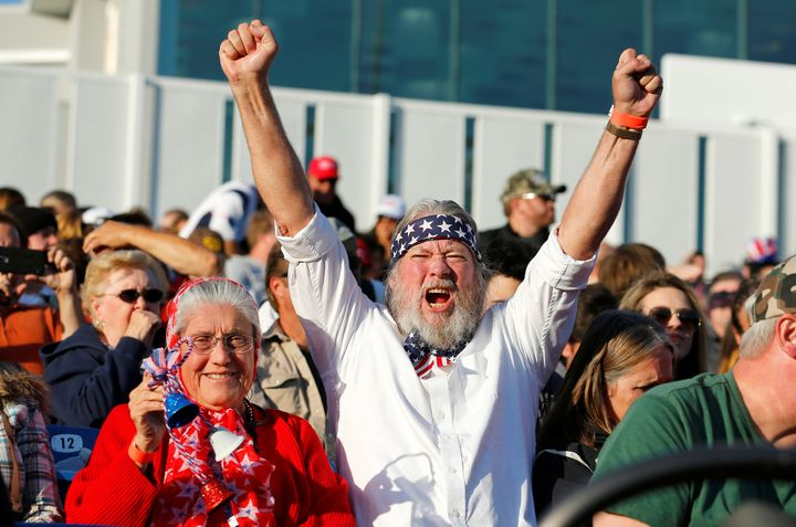 Supporters of Republican U.S. presidential candidate Donald Trump cheer at a campaign rally in Costa Mesa, California April 2