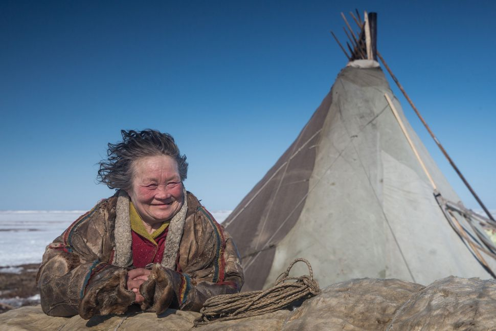 A reindeer herder woman looks on at a nomad camp, 150 km from the town of Salekhard, Yamalo-Nenets Autonomous Okrug, in Russi