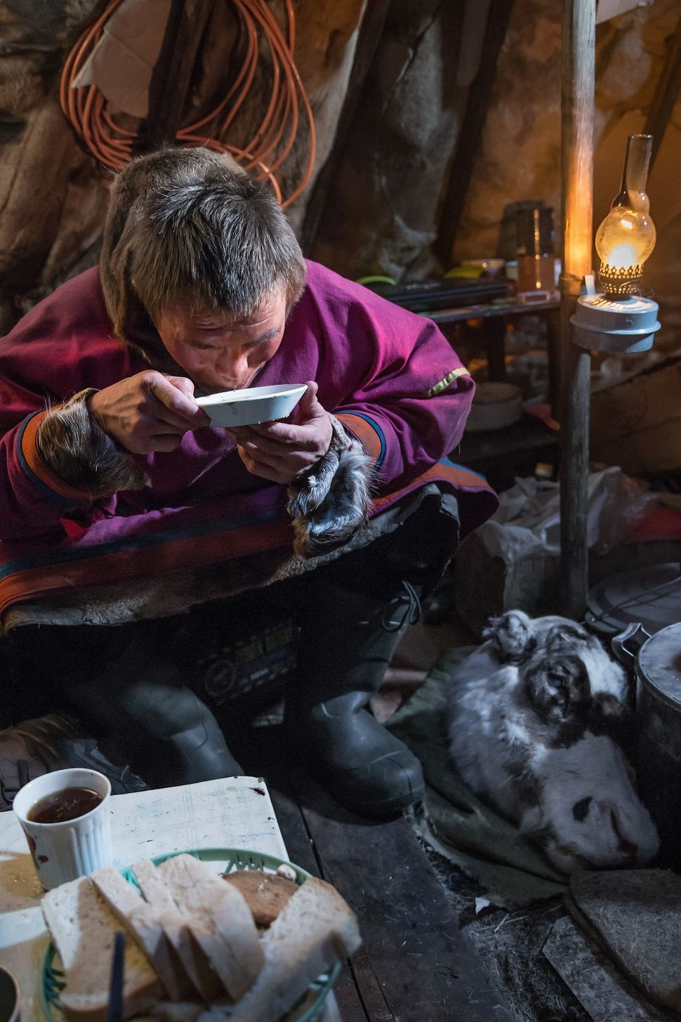 A reindeer herder eats his meal at a nomad camp, 150 km from the town of Salekhard, Yamalo-Nenets Autonomous Okrug, in Russia