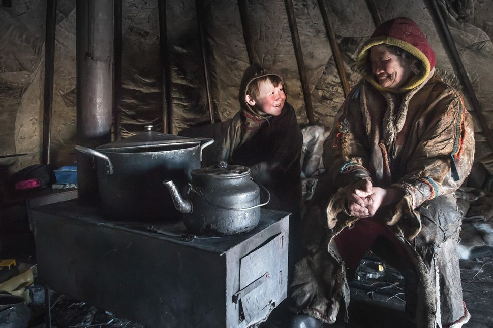 Nenets are seen inside their shelter, 150 km from the town of Salekhard, Yamalo-Nenets Autonomous Okrug, in Russia on April 2