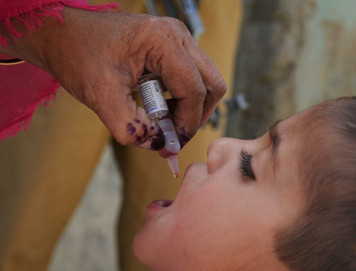 A Pakistani health worker administers polio drops to a child during a polio vaccination campaign in Quetta on April 26, 2016.