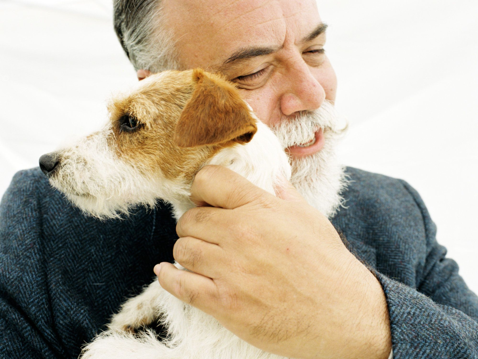Mature man hugging Jack Russell Terrier
