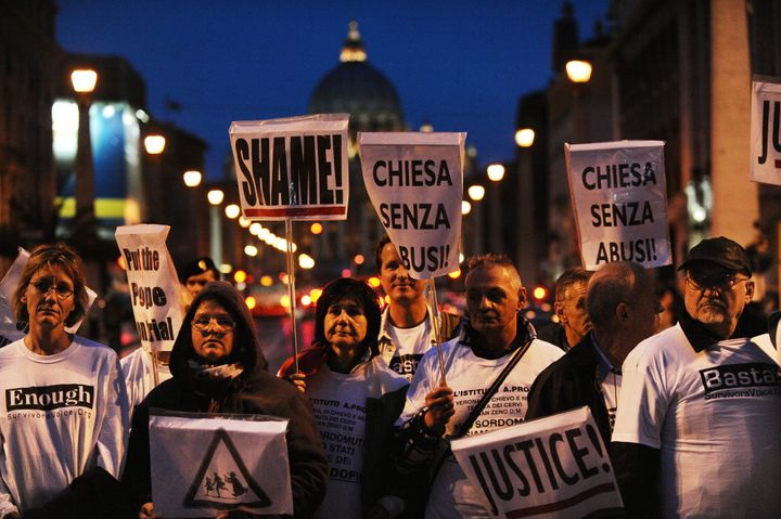 Parents and victims of priest abuse from around the world hold banners during a demonstration in Rome in front of the Vatican