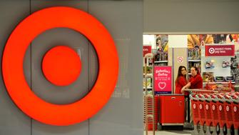 Employees work at a Target store at St. Albert, Alberta, January 15, 2015.  Discount retailer Target Corp has started raising employee wages to a minimum of $10 an hour, its second hike in a year, pressured by a competitive job market and labor groups calling for higher wages at retail chains, sources said, April 18, 2016. REUTERS/Dan Riedlhuber/Files