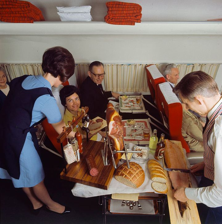 """An """"air hostess"""" serves what the airline calls its""""Scandinavian country-style buffet,"""" 1968."""