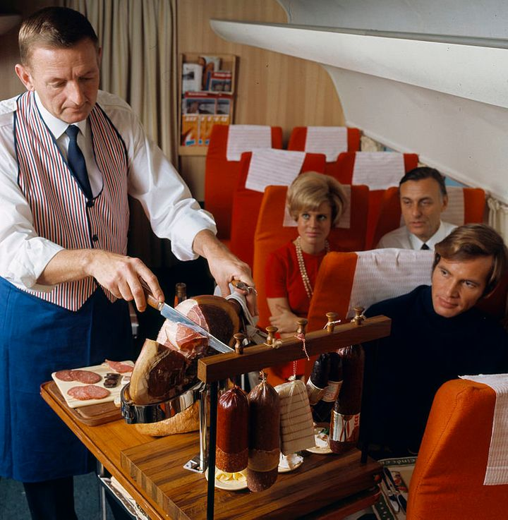 "A ""steward"" slices meat for passengers. Now THAT'S in-flight entertainment."