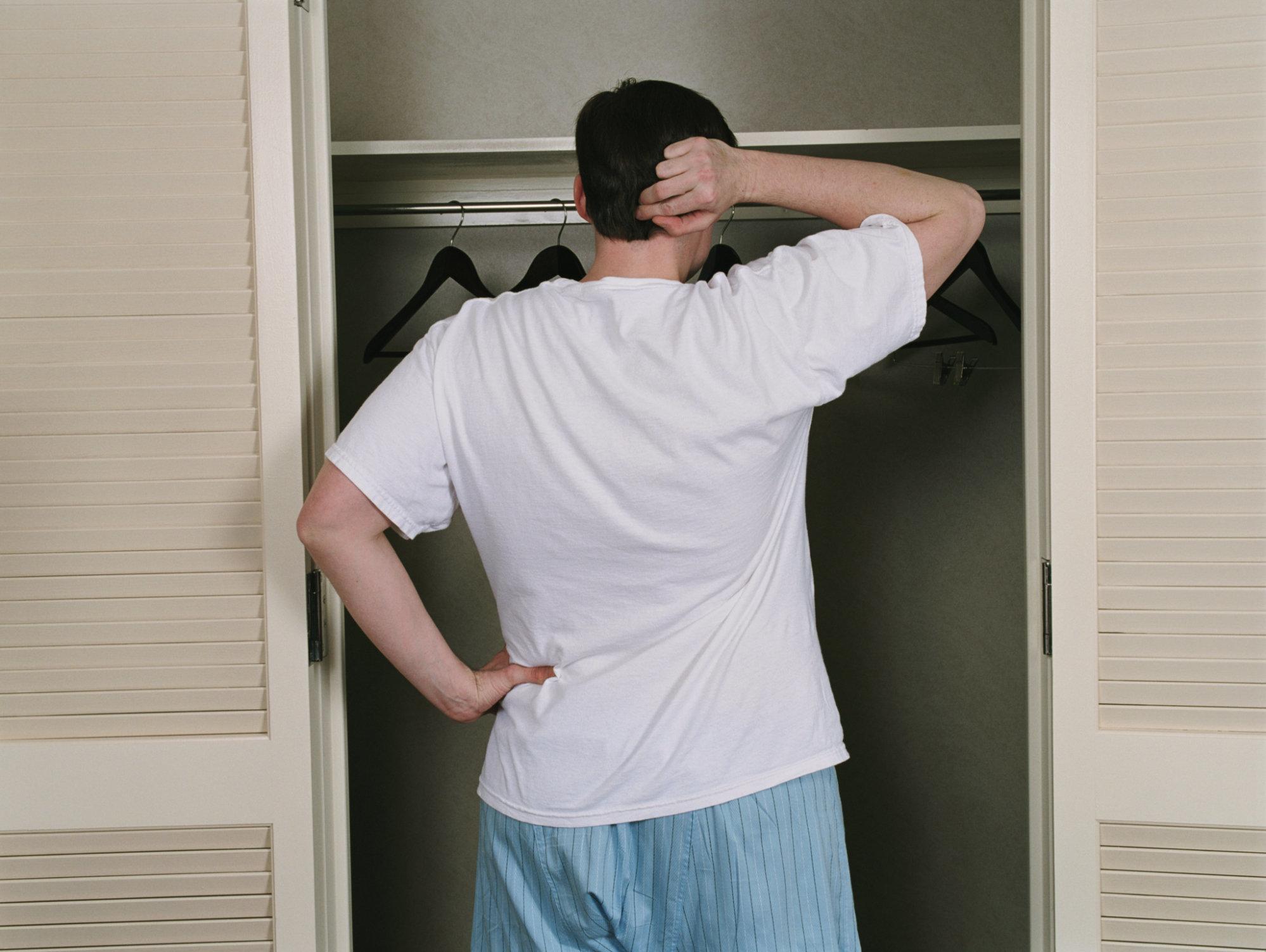 Man Looking at Closet