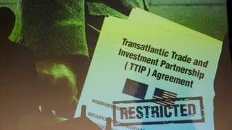 A copy of the leaked TTIP negotiations is projected to a screen during a news conference of the environmental campaign group Greenpeace in Berlin, Germany, May 2, 2016.  REUTERS/Fabrizio Bensch