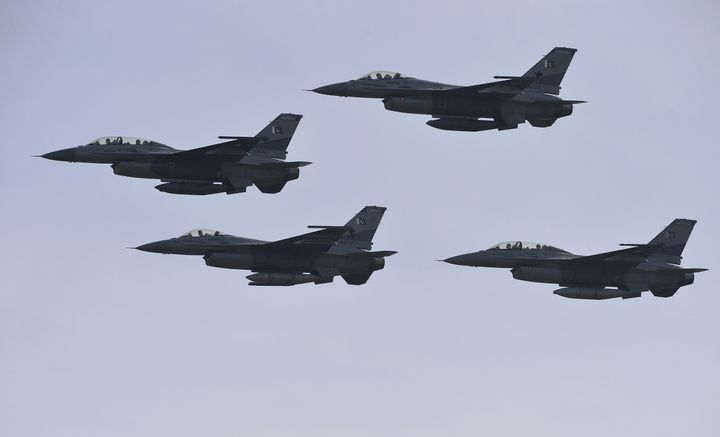 Pakistani F-16 fighter jets fly past during the Pakistan Day military parade in Islamabad on March 23, 2016.