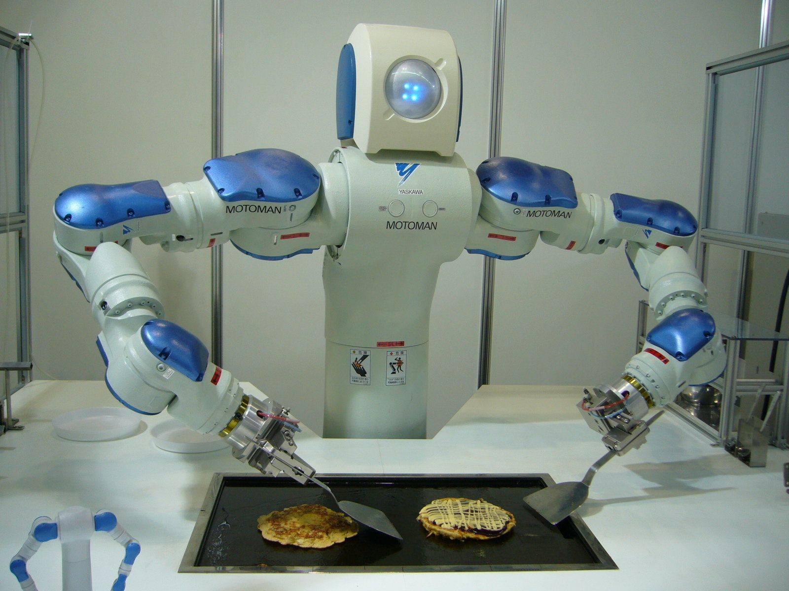 A robot prototype practices his cooking skills.