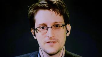 American whistleblower Edward Snowden delivers remarks via video link from Moscow to attendees at a discussion regarding an International Treaty on the Right to Privacy, Protection Against Improper Surveillance and Protection of Whistleblowers in Manhattan, New York September 24, 2015. The event, hosted by global advocacy group Avaaz, was held to coincide with the United Nations General Assembly. REUTERS/Andrew Kelly