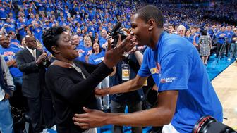 OKLAHOMA CITY, OK - MAY 15 : Kevin Durant #35 of the Oklahoma City Thunder embraces his mother, Wanda Pratt, after defeating the Memphis Grizzlies in Game Seven of the Western Conference Semifinals during the 2011 NBA Playoffs on May 15, 2011 at the Oklahoma City Arena in Oklahoma City, Oklahoma.  NOTE TO USER: User expressly acknowledges and agrees that, by downloading and or using this Photograph, user is consenting to the terms and conditions of the Getty Images License Agreement. Mandatory Copyright Notice: Copyright 2011 NBAE (Photo by Layne Murdoch/NBAE via Getty Images)