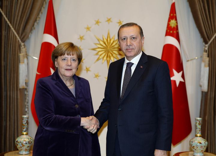 Merkel was accused of getting cozy with Turkish President Tayyip Erdogan over a controversial deal that would help stem refug