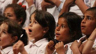 Children sing in the Sonbola choir.