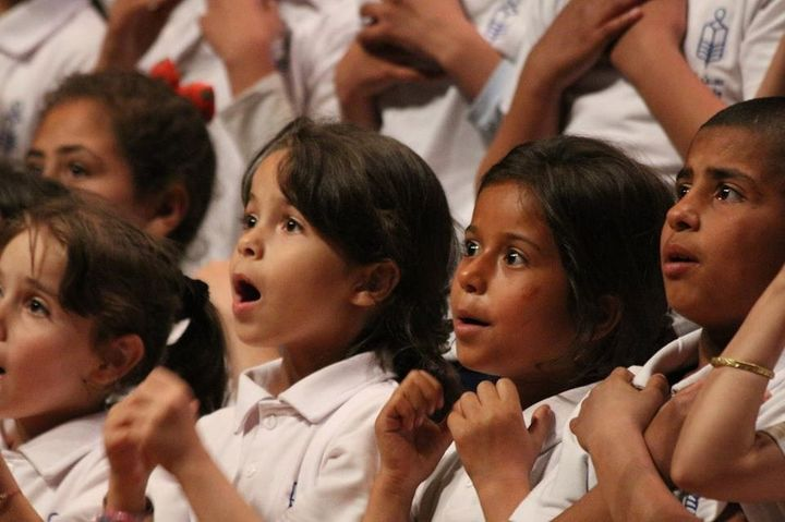 Refugee children sing in the Sonbola choir, anNGO focused on education.