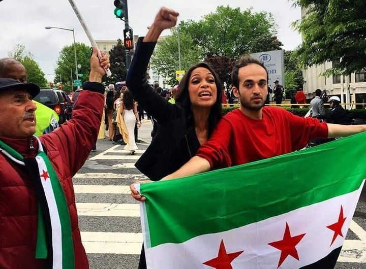 Actress Rosario Dawson demonstrates next to a man in Washington, D.C. Some demonstrators demanded that government blocka