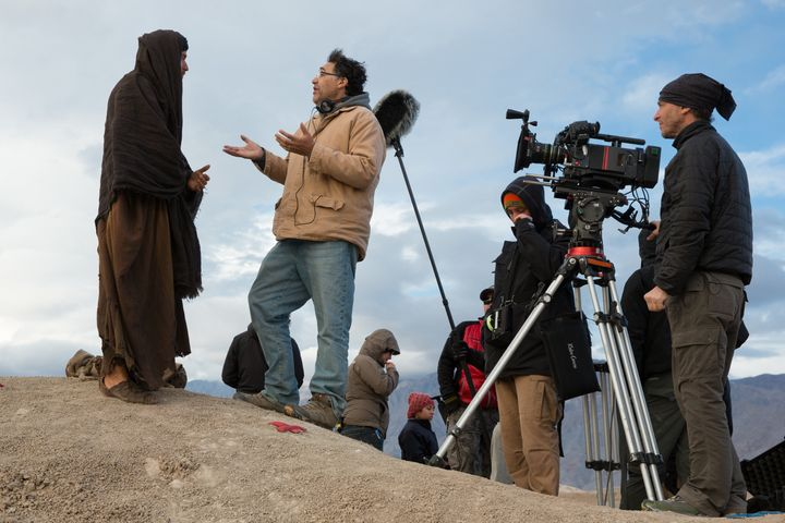 "Ewan McGregor, as Yeshua, chats with director Rodrigo Garcia on set for ""Last Days in the Desert,"" shot by acclaimed cinemato"