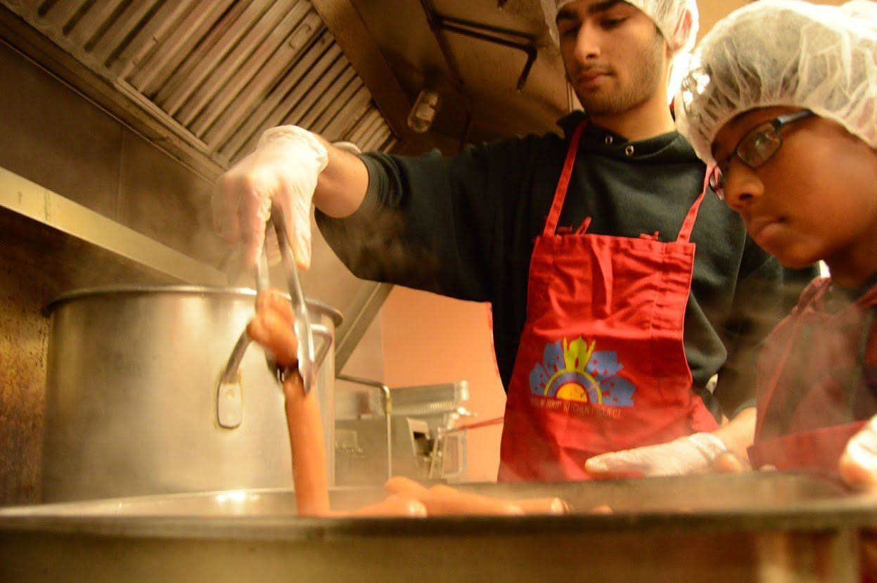 Volunteers prepare a meal in Schenectady, NY.