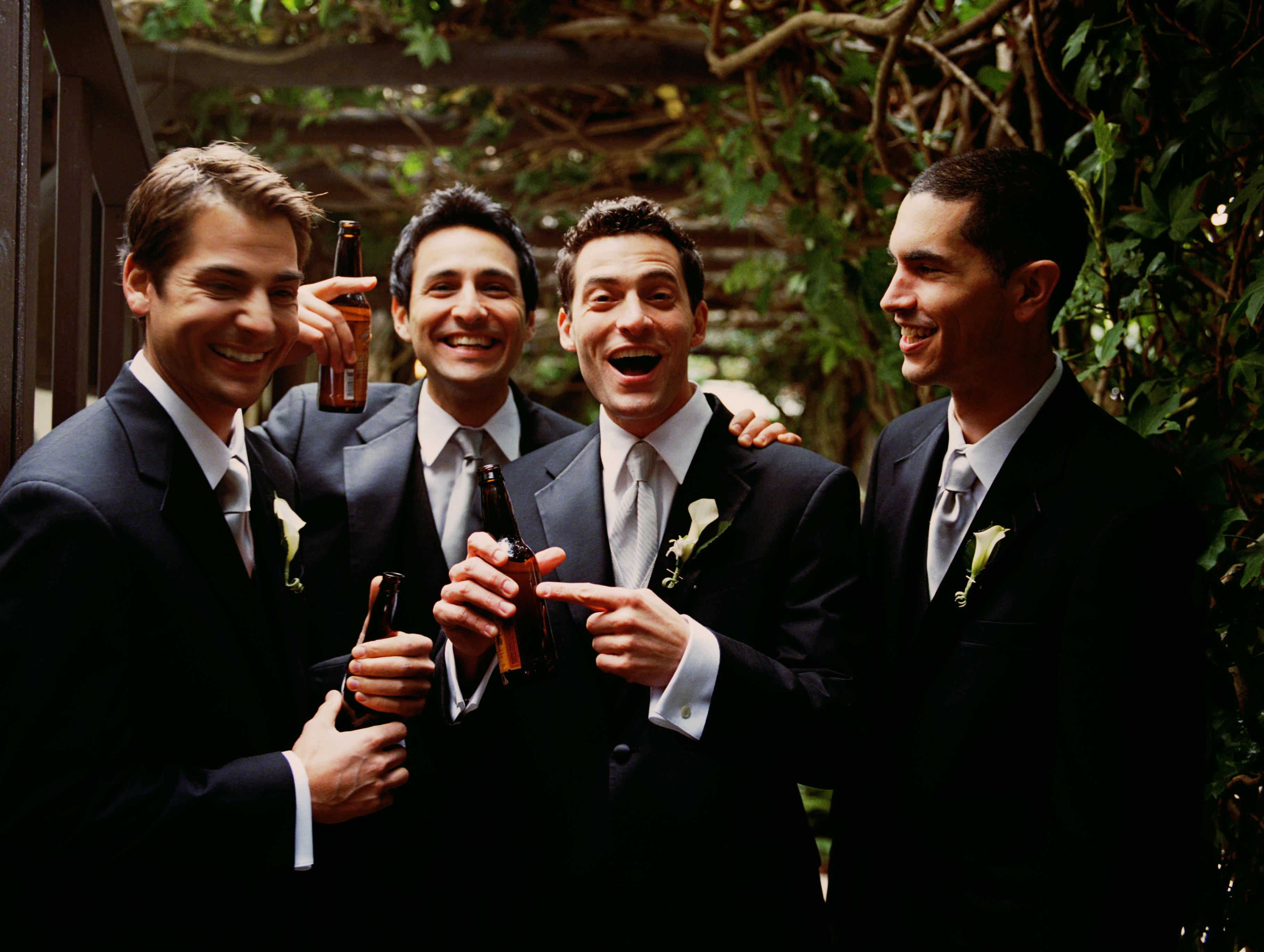 Groom and groomsmen having beer