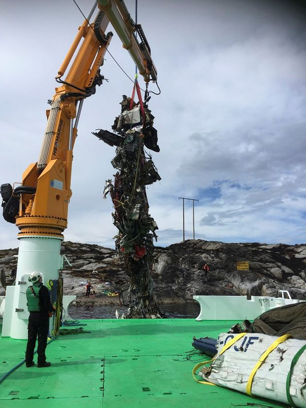 The body of the helicopter is lifted into arescue