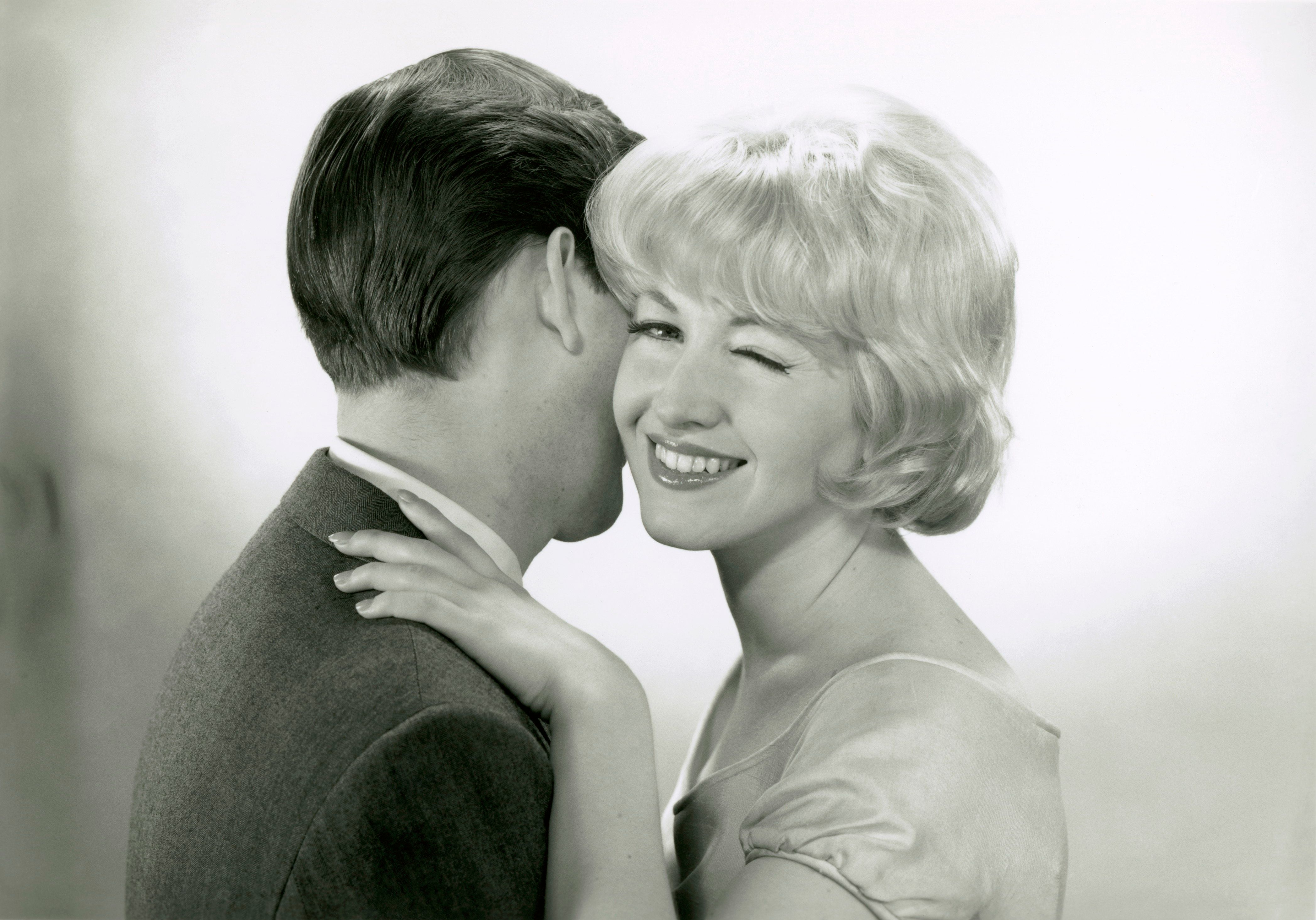 UNITED STATES - CIRCA 1950s:  Man embracing winking woman.  (Photo by George Marks/Retrofile/Getty Images)