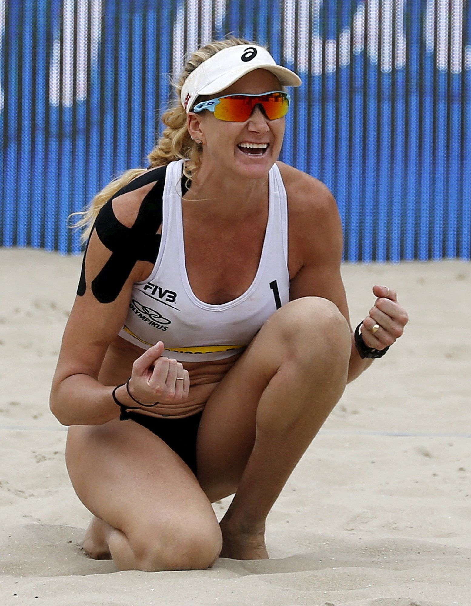 Kerri Walsh of the U.S. celebrates a poiint against Maria Clara Salgado and Carolina Salgado of Brazil during their Rio Open women's beach volleyball match on Copacabana beach in Rio de Janeiro, Brazil, September 4, 2015. The Rio Open is a test event for the Rio 2016 Olympic Games. REUTERS/Sergio Moraes