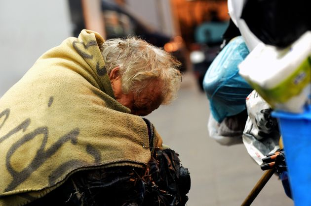 A homeless woman sleeps at the Termini train station in Rome in November 2014. This week, judges in Italy's...