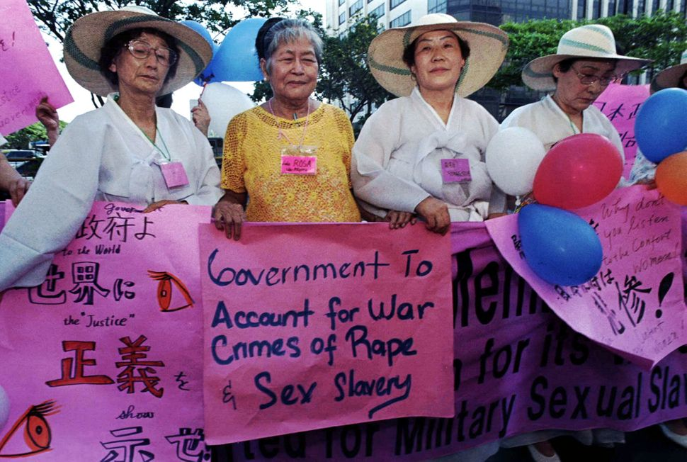 "Rosa Maria Henson (second from left), from the Philippines, joins Korean ""comfort women"" Kim Soon Duk (left) and Yoong Sue Re"