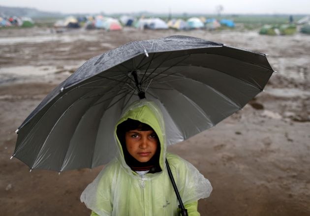 A child refugee in a border station in