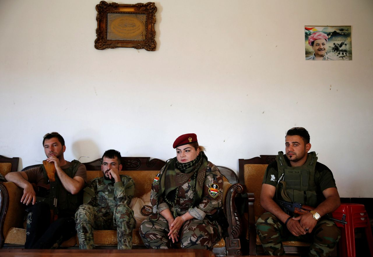 Nauzad sits with other fighters at the site.