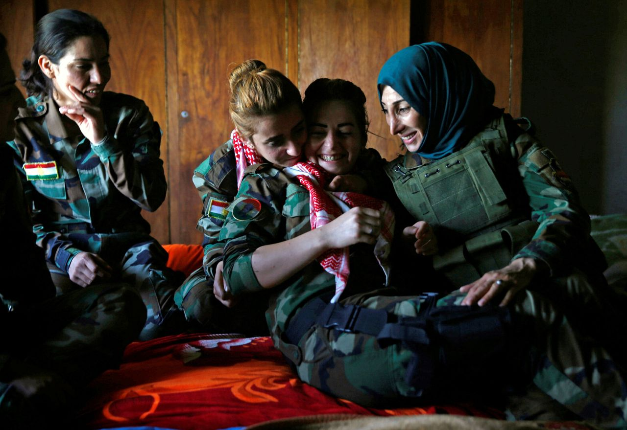 Fighters share a moment in a bedroom near their deployment site.