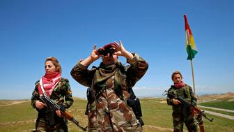 """Iraqi Kurdish female fighter Haseba Nauzad looks through a pair of binoculars during a deployment near the frontline of the fight against Islamic State militants in Nawaran near Mosul, Iraq, April 20, 2016. When Islamic State swept into the northern Iraqi town of Sinjar in 2014, a few young Yazidi women took up arms against the militants attacking women and girls from their community. The killing and enslaving of thousands from Iraq's minority Yazidi community focused international attention on the group's violent campaign to impose its radical ideology and prompted Washington to launch an air offensive. It also prompted the formation of this unusual 30-woman unit made up of Yazidis as well as Kurds from Iraq and neighbouring Syria. For them, only one thing matters: revenge for the women raped, beaten and executed by the jihadist militants.REUTERS/Ahmed Jadallah  SEARCH """"WOMEN NAWARAN"""" FOR THIS STORY. SEARCH """"THE WIDER IMAGE"""" FOR ALL STORIES"""