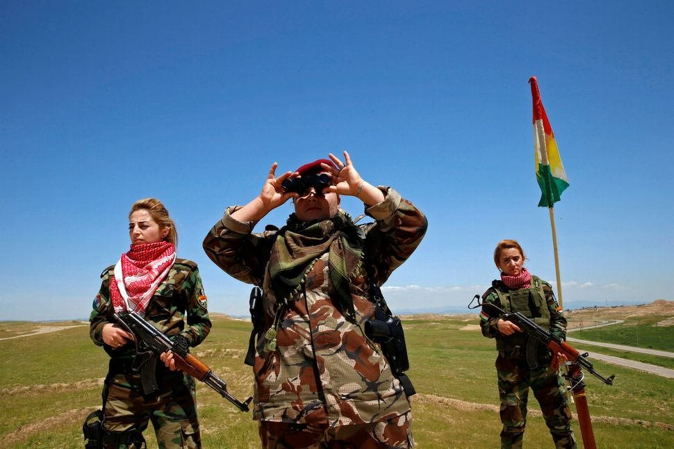 A group of young women tookup arms against the self-styled Islamic State when the militant group attacked northern Iraq