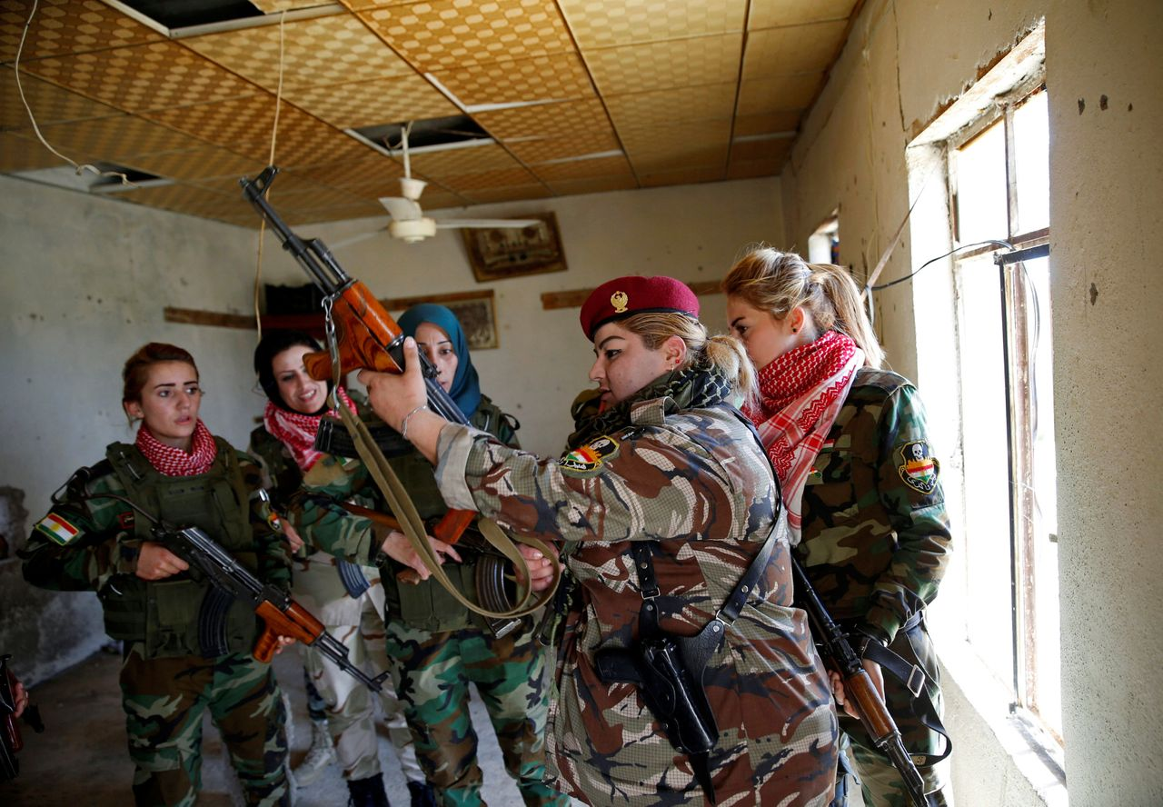 Nauzad is pictured some of her fellow fighters. The unit has about 30 members.