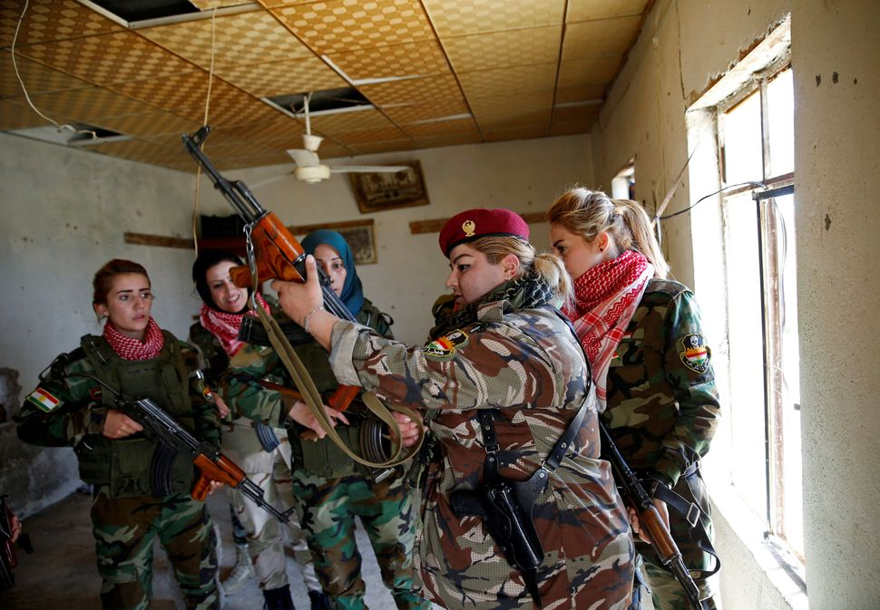 Nauzad is picturedsome of her fellow fighters. The unit has about 30 members.