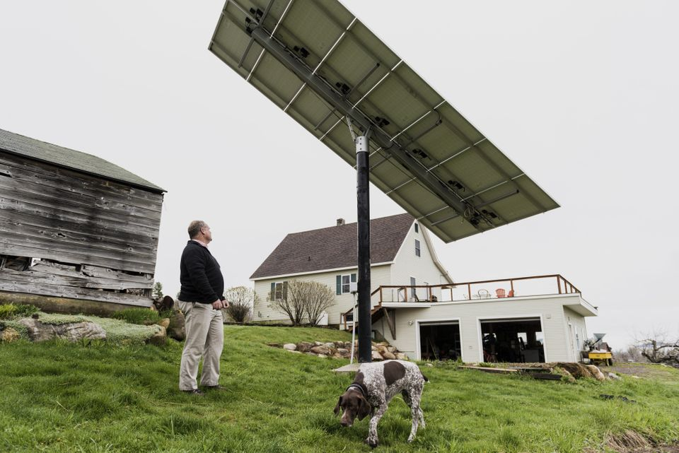 A customer inspects a solar panel that is linked to a Tesla Motors Inc. Powerwall at a home in Monkton, Vermont, U.S., on Mon
